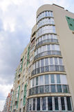 Photo of green white modern apartment building Stock Images