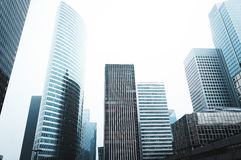 Photo of Grey Medium Rise and High Rise Buildings Under White Sky during Daytime Stock Photography
