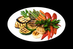 Photo of grilled vegetables on a white plate Stock Photo