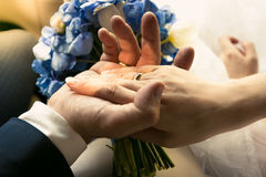 Photo of groom holding brides hand in car Stock Photos