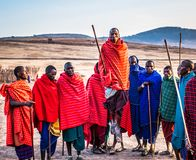 Photo of Group of Men Wearing Assorted Scarves Holding Sticks Royalty Free Stock Photo
