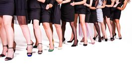 A group of women in black dresses and shoes royalty free stock photos
