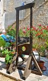 The guillotine in the city garden. Photo of a guillotine  on a small garden in Dubrovnik - Croatia - July 2010 Royalty Free Stock Photos