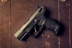 A photo of a gun on a grunge surface Royalty Free Stock Images