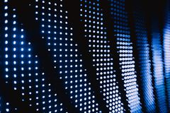 Halftone blue blurred led lights. Photo of halftone blue blurred led lights in the night club darkness royalty free stock image