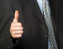 A photo of a hand doing a thumb up gesture Stock Photo