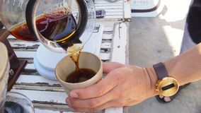 Hand drip coffee, barista pouring hot water over roasted grinded coffee powder making drip brew coffee. Photo of hand drip coffee, barista pouring hot water over Royalty Free Stock Photo