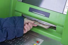 Photo of hand taking from ATM Ukrainian hryvnas. Photo of the hand taking from ATM Ukrainian hryvnas royalty free stock photography