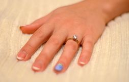 Photo of hand with wedding ring with diamond on white background Royalty Free Stock Images