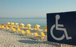 Photo handicap sign. On the send beach Stock Image