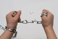 Photo of hands holding a broken chain. Photo of hands holding a broken mettalic chain stock photography