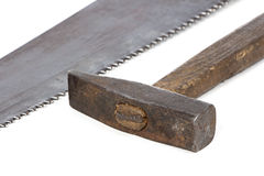 Photo of handsaw's teeth and hammer Stock Images