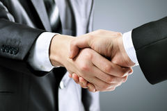 Photo of handshake  business partners after signing promising contract on a black background Royalty Free Stock Photos
