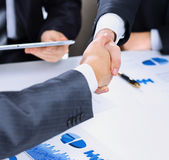 Photo of handshake  business partners after signing promising contract Close-up Royalty Free Stock Photo