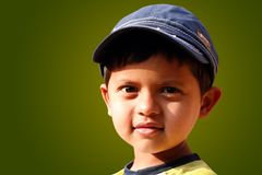 Photo of handsome indian boy with a cap smiling Stock Image