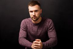 Handsome serious man isolated on a black background royalty free stock photos
