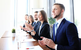 Photo of happy business people. Applauding at conference Stock Image
