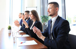 Photo of happy business people. Applauding at conference Stock Photos