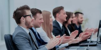Successful business people looking happy and confident. Photo of happy business people applauding at conference Royalty Free Stock Image