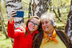 Happy elderly woman with her daughter stock images