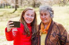 Happy elderly woman with her daughter stock photo