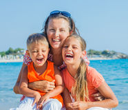 Photo of happy family on the beach Stock Photography