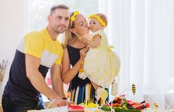 Happy family. Dad cuts the birthday cake. Photo of Happy family. Dad cuts the birthday cake stock photo