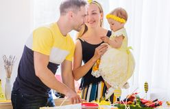 Happy family. Dad cuts the birthday cake. Photo of Happy family. Dad cuts the birthday cake stock image