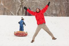 Photo of happy father and son on winter walk with tubing. During day Royalty Free Stock Images
