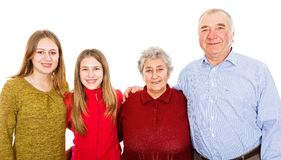 Happy grandparents and granddaughters. Photo of happy grandparents and granddaughters smiling for the camera Royalty Free Stock Image