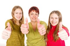 Happy mother with daughters. Photo of happy mother with daughters showing thumbs up Stock Photo