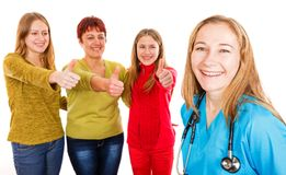 Happy mother with daughters and young doctor. Photo of happy mother with daughters showing thumbs up for the young daughters Stock Images