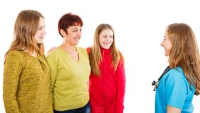Happy mother with daughters and young doctor. Photo of happy mother with daughters and young doctor Royalty Free Stock Photo
