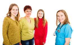 Happy mother with daughters and young doctor. Photo of happy mother with daughters and young doctor Royalty Free Stock Images