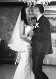 Photo of happy newly married couple dancing at restaurant Stock Images