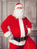 Photo of happy Santa Claus with big bag of presents Royalty Free Stock Image