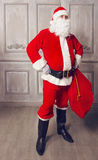 Photo of happy Santa Claus with big bag of presents Stock Photo