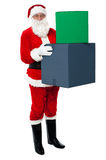 Photo of happy Santa Claus delivering gifts Royalty Free Stock Photography