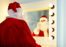 Photo of happy Santa Claus talking to the phone Stock Images