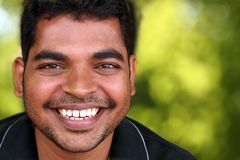 Photo of happy & smiling middle-aged Indian youth Royalty Free Stock Images