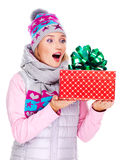 Photo of happy surprised woman with a christmas gift Stock Image