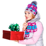 Photo of happy surprised woman with a christmas gift Stock Photos