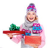 Photo of happy surprised woman with a christmas gift Royalty Free Stock Photos