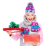 Photo of happy surprised woman with a christmas gift Royalty Free Stock Photo