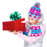 Photo of happy surprised woman with a christmas gift Royalty Free Stock Photography