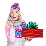 Photo of happy woman with a gift in a winter outerwear Royalty Free Stock Image