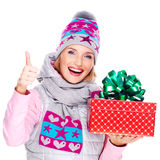 Photo of happy woman with a gift in a winter outerwear Royalty Free Stock Photo