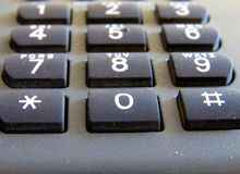 Photo haute étroite classique de numéros de téléphone macro Photo stock