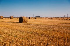 Haystack on a sloping field. Photo of  haystack on a sloping field Stock Images