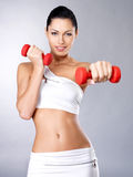 Photo of a healthy training young woman with dumbbells Stock Photos